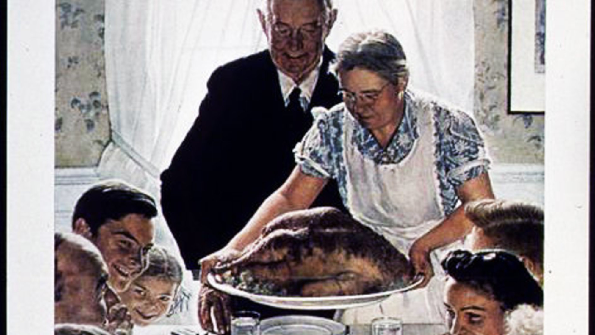 Ah, a traditional Thanksgiving dinner, where the wife does all the work and the husband just carves the bird, then watches football. But this year, our Thanksgiving was nothing like this scene. Not even close.